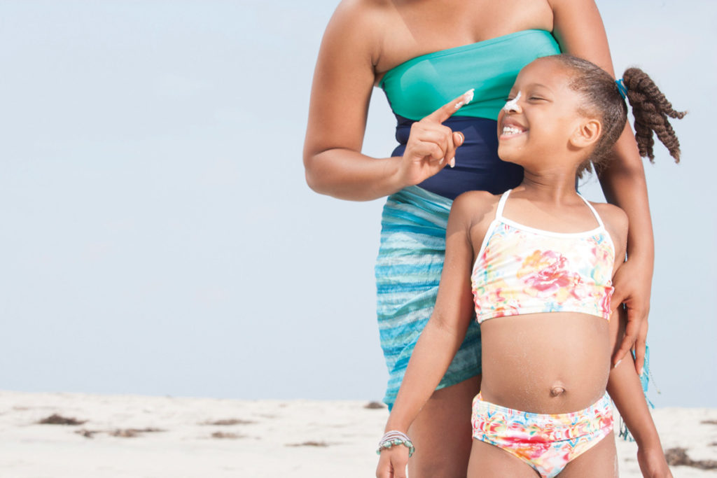storyblocks mom putting sunscreen on daugher by bs9irso